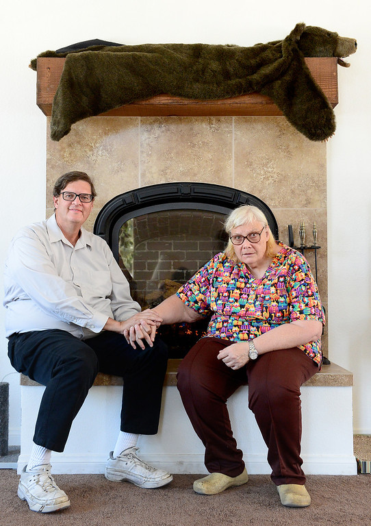 """. Jim Crabtree and his wife Rita Delehanty sit on the hearth of their gas furnace fireplace of their green home \""""Steel Memories\"""" in Hacienda Heights Friday, April 19, 2013. The steel home was completed in 2011. (SGVN/Staff Photo by Sarah Reingewirtz)"""