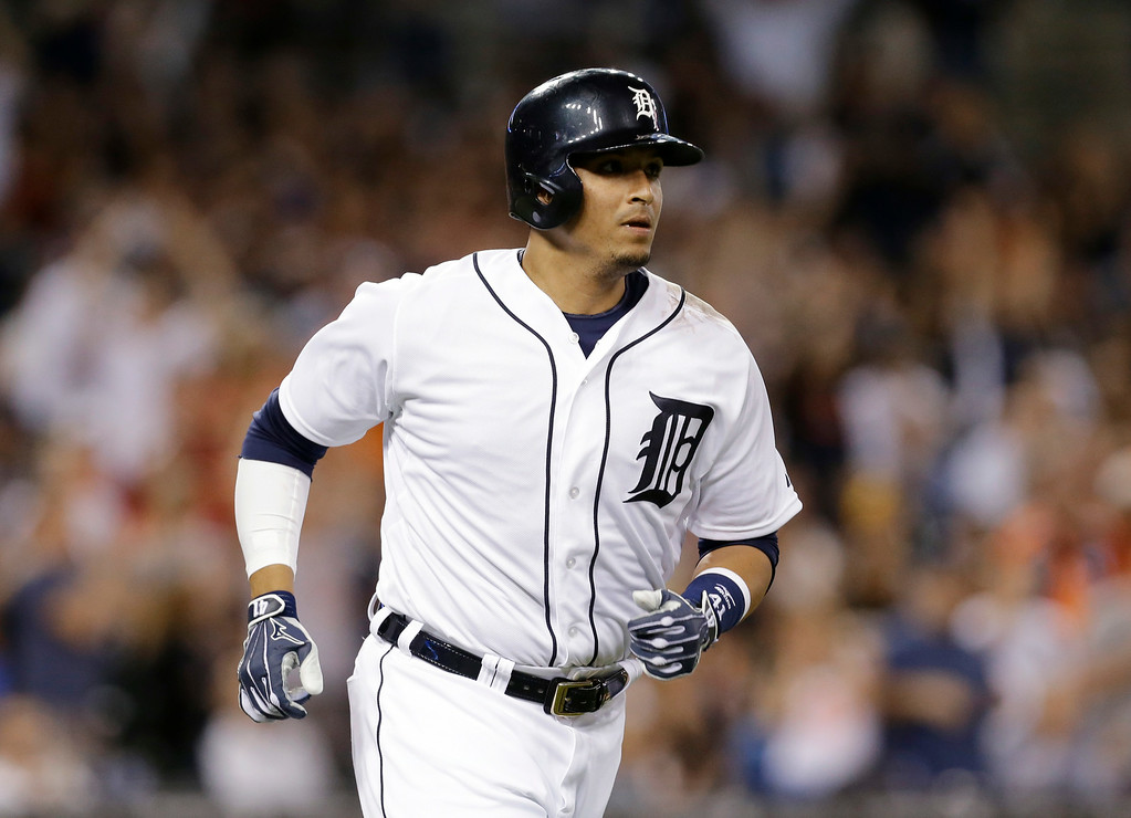 . Detroit Tigers\' Victor Martinez watches his solo home run against the New York Yankees in the sixth inning of a baseball game in Detroit, Wednesday, Aug. 27, 2014. (AP Photo/Paul Sancya)