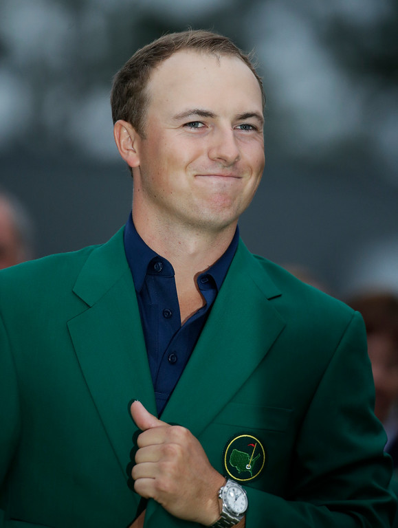 . Jordan Spieth wears his green jacket after winning the Masters golf tournament Sunday, April 12, 2015, in Augusta, Ga. (AP Photo/Charlie Riedel)
