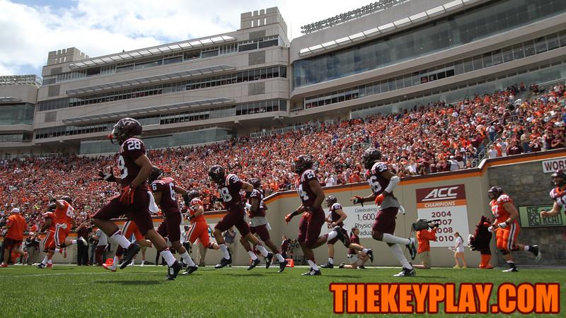 The Hokies run onto the field before the start of the spring game. (Mark Umansky/TheKeyPlay.com)