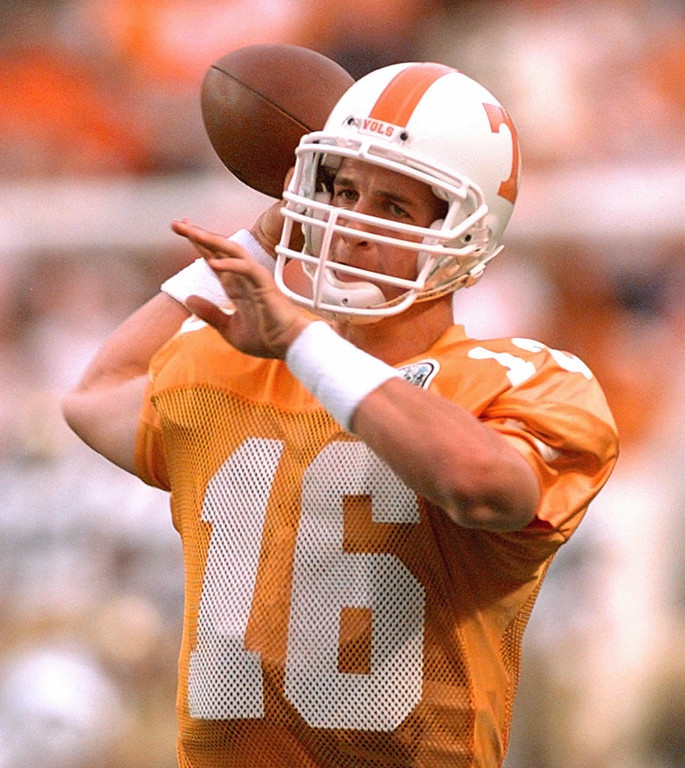 . University of Tennessee quarterback Peyton Manning throws during warm-ups before playing UCLA on Sept. 7, 1996, in Knoxville, Tenn. From the national rankings to the media demands to the long line of students waiting for tickets, everything about next weeks\'s Tennessee-Florida game is bigger than usual. (AP Photo/Mark Humphrey)