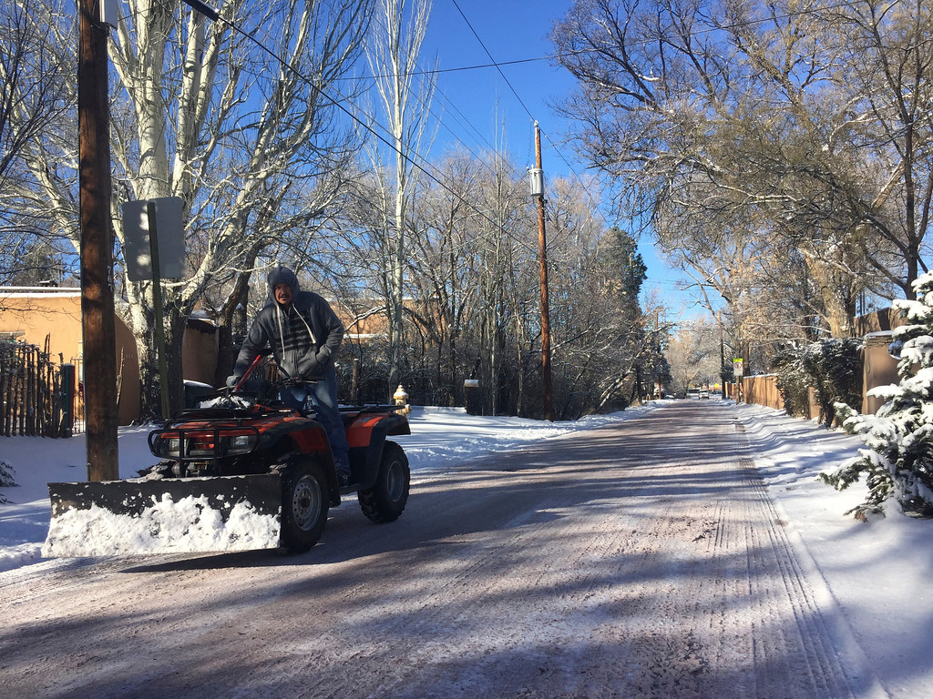 . Residents of Santa Fe, N.M., dig out from a winter storm that closed schools and blanketed nearby ski resorts with snow on Friday, Jan. 6, 2017. Authorities reported difficult driving conditions on on the state\'s two main interstate highways. (AP Photo/Morgan Lee)