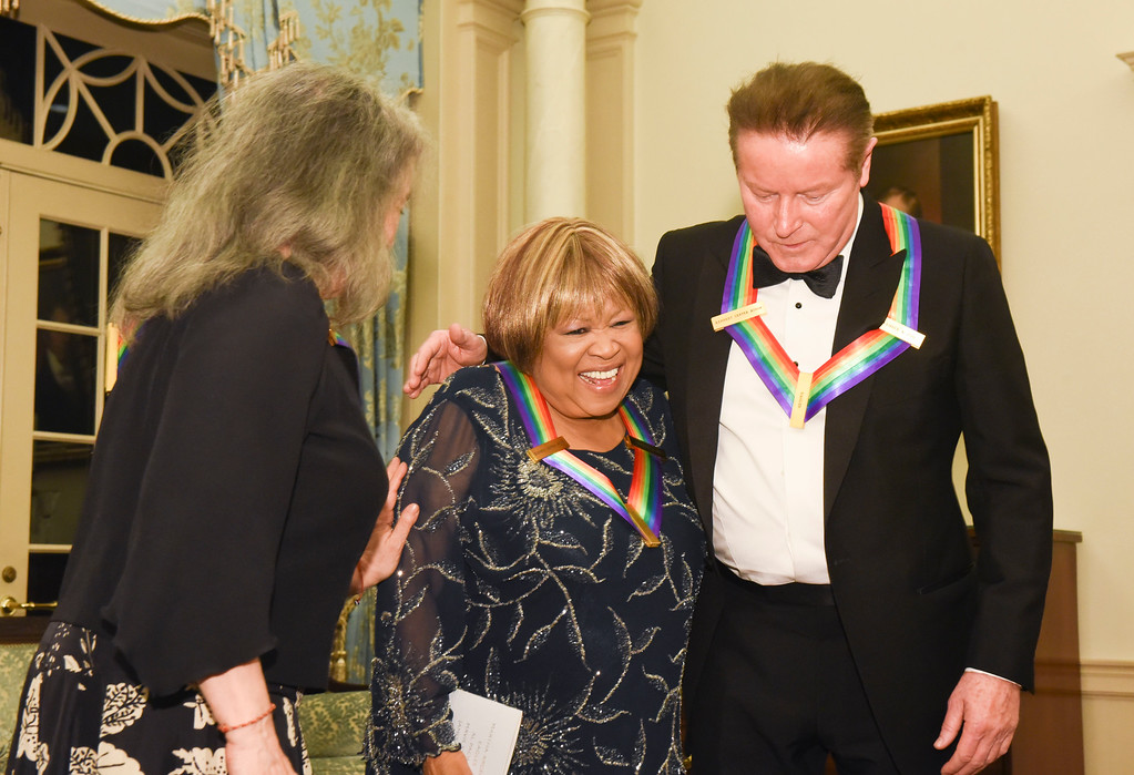. Kennedy Center Honoree Mavis Staples, center, meets with fellow honorees Don Henley, right, and Martha Argerich following the State Department for the Kennedy Center Honors gala dinner on Saturday, Dec. 3, 2016 in Washington. (AP Photo/Kevin Wolf)