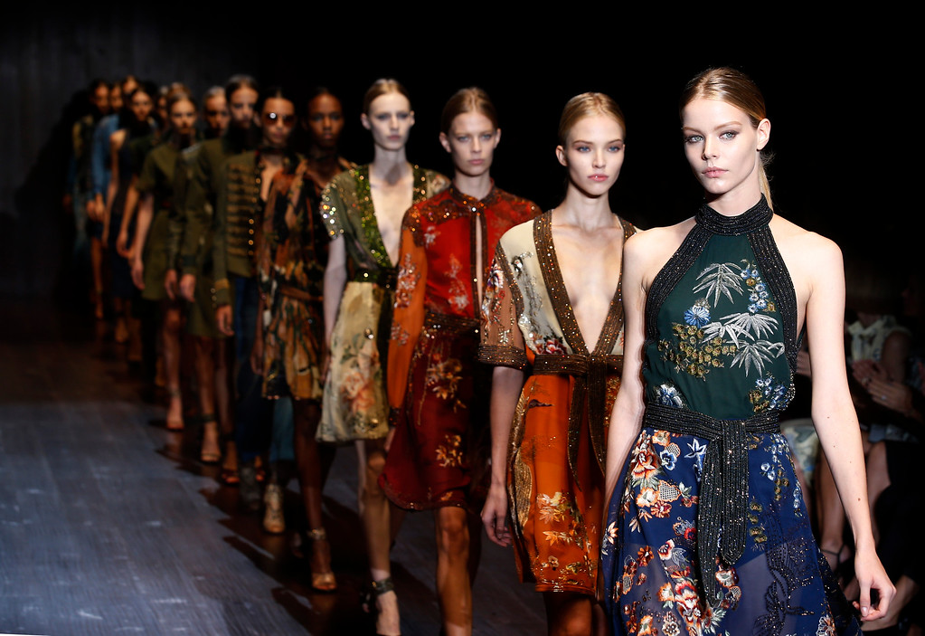 . Models wear creations for Gucci women\'s spring-summer 2015 collection, part of the Milan Fashion Week, unveiled in Milan, Italy, Wednesday, Sept. 17, 2014. (AP Photo/Luca Bruno)
