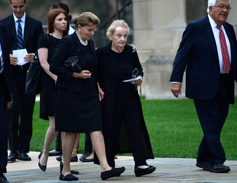 . Former Secretary of State Madeleine Albright, center, arrives to attend a memorial service for Sen. John McCain, R-Ariz., at the Washington National Cathedral in Washington, Saturday, Sept. 1, 2018. McCain died Aug. 25 from brain cancer at age 81. (AP Photo/Susan Walsh)