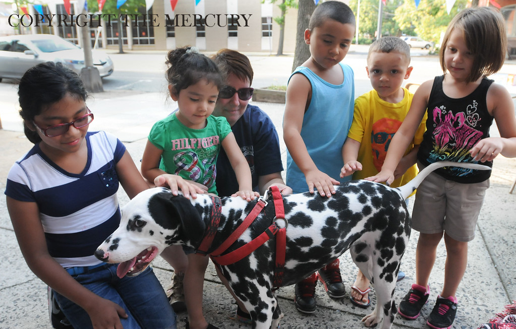 . Allison Smale center with Goodwill Fire Co. with her dalmatian \'Maverick\' as children pet the dog. Goodwill participated with First United Methodist Church on High St. as part of the National Night Out events in Pottstown. Photo by John Strickler The Mercury
