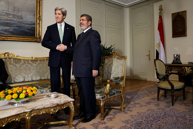 . U.S. Secretary of State John Kerry, left, shakes hands with Egyptian President Mohamed Morsi at the Presidential Palace in Cairo, Egypt on Sunday, March 3, 2013. U.S. Secretary of State John Kerry met with Egypt\'s president Sunday, wrapping up a visit to the deeply divided country with an appeal for unity and reform. The U.S. is deeply concerned that continued instability in Egypt will have broader consequences in a region already rocked by unrest. (AP Photo/Jacquelyn Martin, Pool)