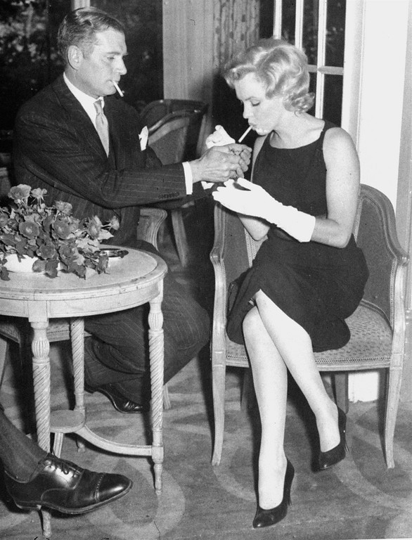 ". Sir Laurence Olivier gives a light to Marilyn Monroe July 15, 1956, at London\'s Savoy Hotel. They announced that she would co-star with Olivier in the film ""The Prince and the Showgirl.\"" (AP Photo)"