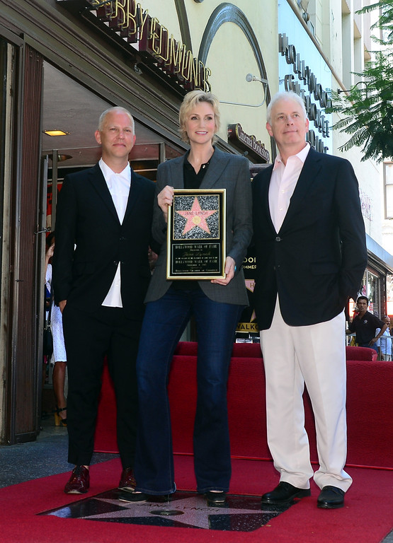 . Actress Jane Lynch poses with  screenwriters Ryan Murphy (L) and Christopher Guest (R) during a cermony honoring her with the 2,505 Star on the Hollywood Walk of Fame in the category of television on September 4, 2013 in Hollywood, California.        ( FREDERIC J. BROWN/AFP/Getty Images)