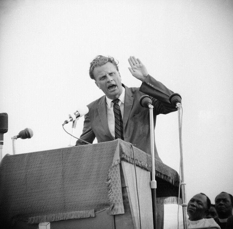 . Evangelist Billy Graham at his first meeting at the Sports Stadium in Accra, Ghana, Jan. 24, 1960. (AP Photo/Royale)