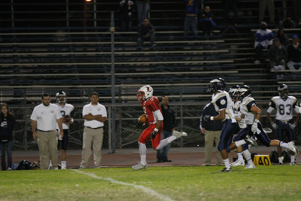 . Austin Manigo #9 of Lawndale runs down the sideline for a touchdown against the defense of El Segundo in a Pioneer League matchup at Leuzinger High School on Friday, October 11, 2013 in Lawndale, Calif.  (Michael Yanow / For the Daily Breeze)