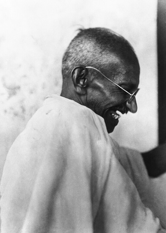 . 1930: Mahatma Gandhi. Mahatma Gandhi laughing around April 23, 1930. (AP Photo)