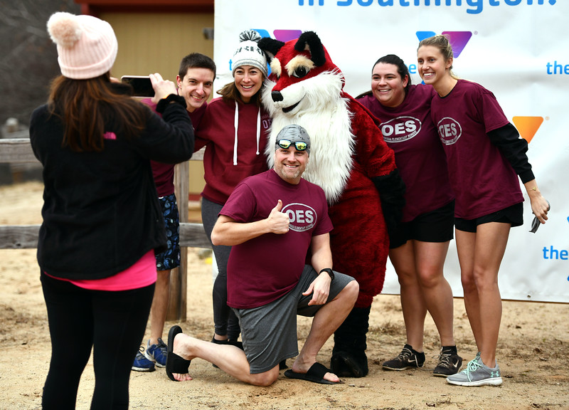 1/18/2020 Mike Orazzi | Staff Plungers during the Annual Camp Sloper Polar Plunge at Sloper Pond in Southington Saturday.