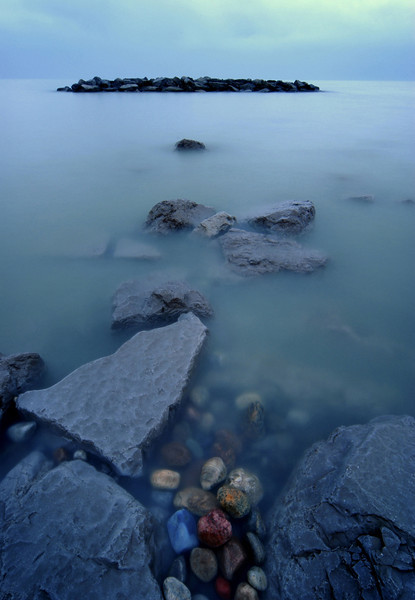 """Stormy weather, water and colourful rocks , """"The Beach"""" Toronto."""