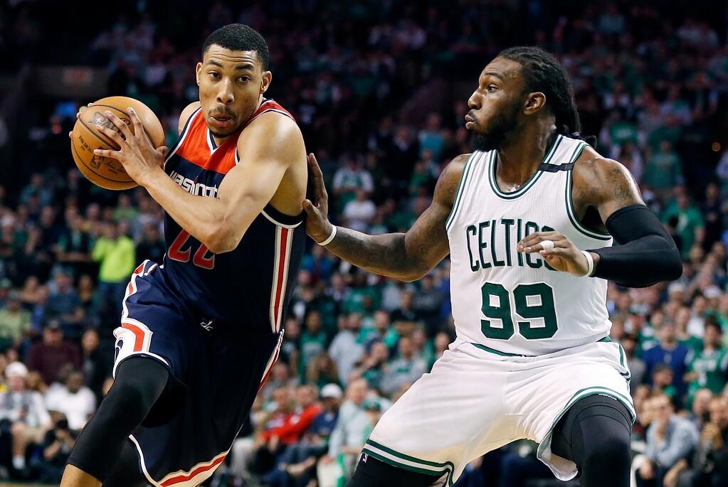 . Washington Wizards\' Otto Porter Jr. (22) drives past Boston Celtics\' Jae Crowder (99) during the fourth quarter of a second-round NBA playoff series basketball game, Sunday, April, 30, 2017, in Boston. The Celtics won 123-111. (AP Photo/Michael Dwyer)