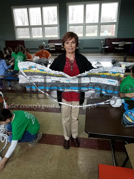 4 Column Photo. Christine Kunkel shows off a mat in progress and HIS Kids Christian School students covert plastic bags to PLARN PHOTOS BY ERIC FREEHLING