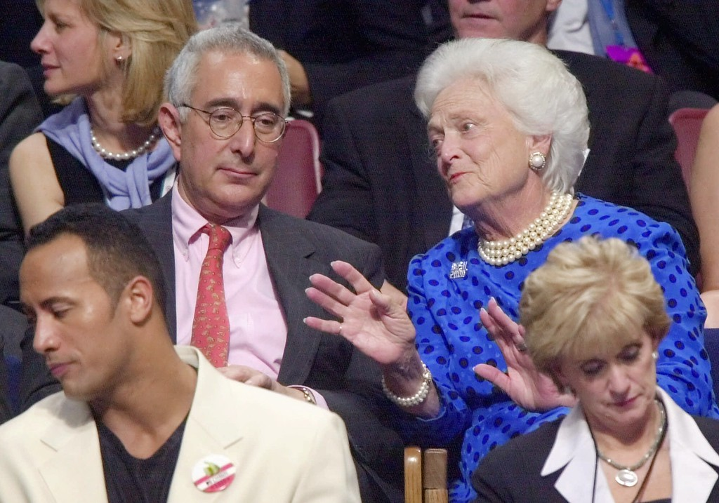 . Former first lady Barbara Bush talks with Comedy Central\'s Ben Stein at the Republican National Convention in Philadelphia on Wednesday, Aug. 2, 2000.  Stein was a speechwriter in the Nixon administration. At bottom left is World Wrestling Federation champion, The Rock.  (AP Photo/Mark Humphrey)