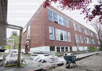 McMenamin brothers give the media a sneak peak tour of their next big hotel and brewery conversion project at the under renovation historic W.A. Anderson School in Bothell, Washington