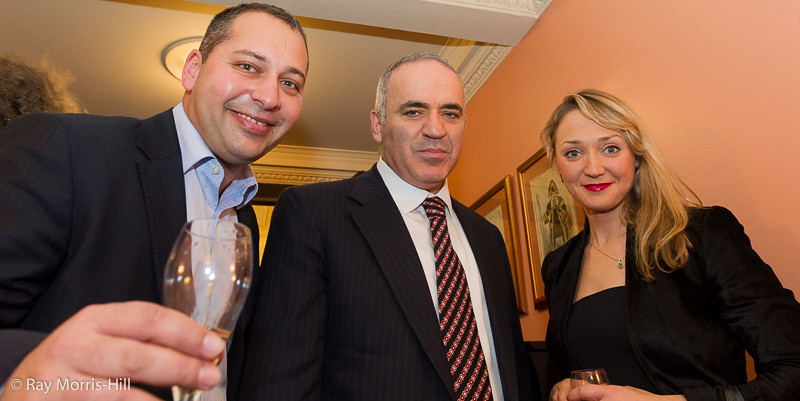 Garry Kasparov poses for photos with guests