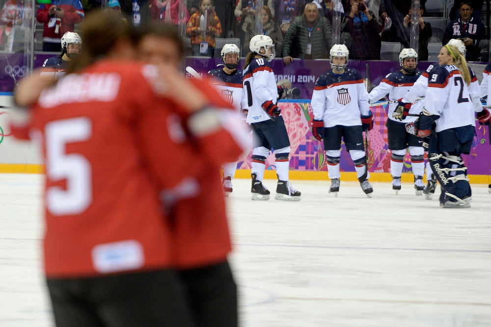 . SOCHI, RUSSIA - FEBRUARY 20: Team U.S.A. looks on as Canada celebrates the game-winning goal by Marie-Philip Poulin (29) during the overtime period of Canada\'s 3-2 gold medal ice hockey win over the U.S.A. Sochi 2014 Winter Olympics on Thursday, February 20, 2014 at Bolshoy Ice Arena. (Photo by AAron Ontiveroz/ The Denver Post)