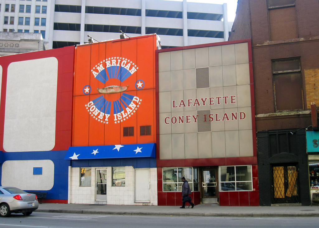 . This Dec. 2, 2014 photo shows American Coney Island and Lafayette Coney Island, rival eateries located side by side in downtown Detroit. Coney-style hot dogs are a tradition in Michigan, served with onions, mustard and chili. The two restaurants were founded by brothers who were Greek immigrants in the early 20th century and many locals swear allegiance to one or the other. (AP Photo/Beth J. Harpaz)
