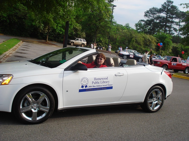 Deborah Fout, Library Director, driving a 2009 Pontiac G6 Convertible from Crown Pontiac.jpg