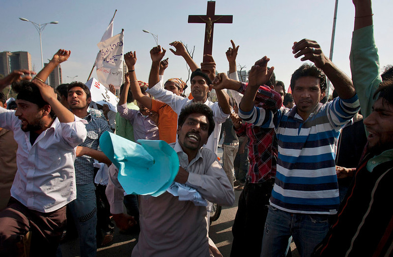 . Pakistani Christians chant slogans during a demonstration demanding that the government rebuild their homes after they were burned down following an alleged blasphemy incident, in Islamabad, Pakistan, Sunday, March 10, 2013. The incident in Lahore began on Friday, March 8, 2013 after a Muslim accused a Christian man of blasphemy, an offense that in Pakistan is punished by life in prison or death. (AP Photo/Anjum Naveed)