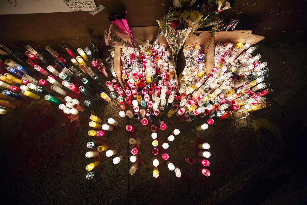 ". Candles stand lit on a street corner making up a memorial for 16-year-old Kimani ""Kiki\"" Gray, after he was killed in a New York Police Department shooting  in the Brooklyn borough of New York, March 11, 2013. Picture taken March 11, 2013. REUTERS/Lucas Jackson"