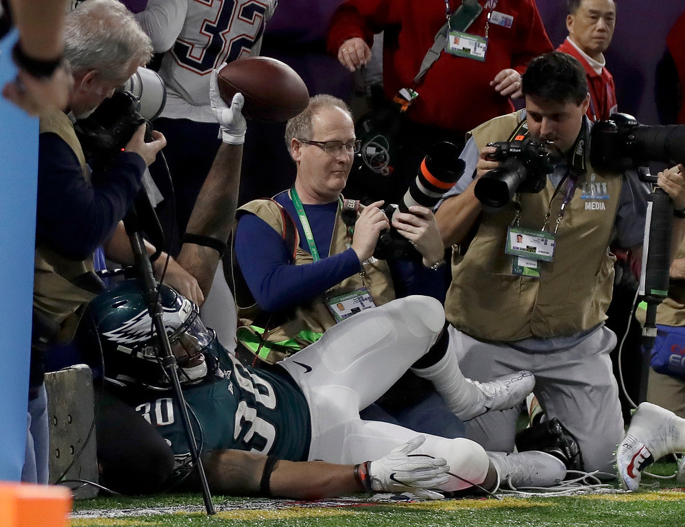 . Philadelphia Eagles\' Corey Clement crashes into photographers after a touchdown catch during the second half of the NFL Super Bowl 52 football game against the New England Patriots Sunday, Feb. 4, 2018, in Minneapolis. (AP Photo/Matt Slocum)