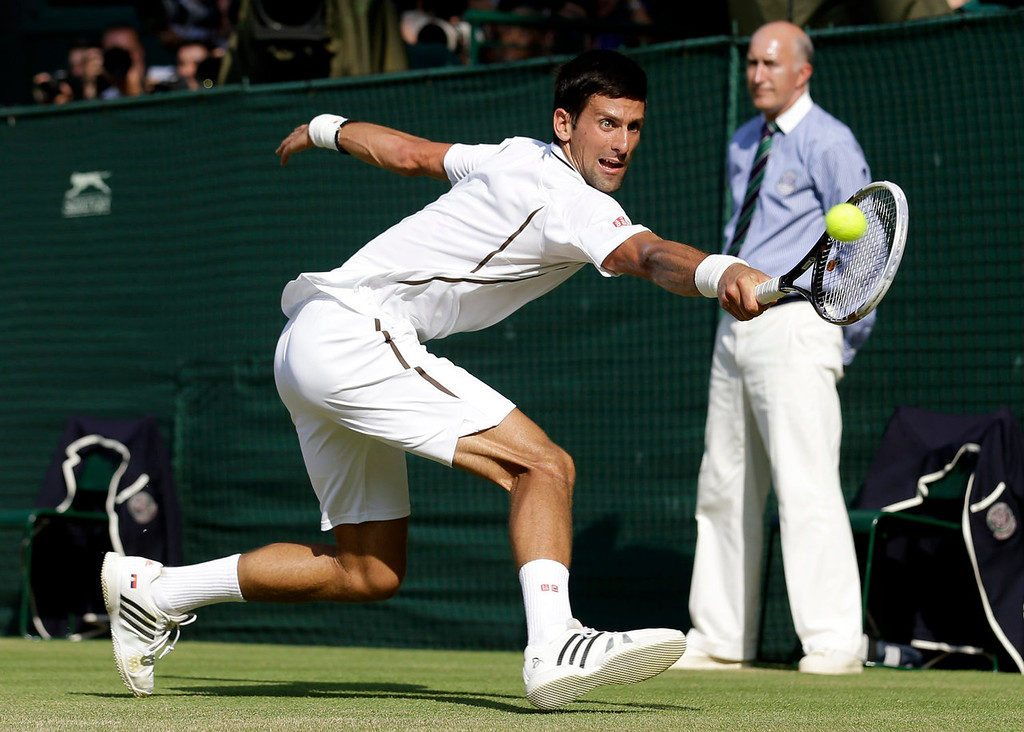 . Novak Djokovic of Serbia plays a return to Andy Murray of Britain during the Men\'s singles final match at the All England Lawn Tennis Championships in Wimbledon, London, Sunday, July 7, 2013. (AP Photo/Anja Niedringhaus, Pool)