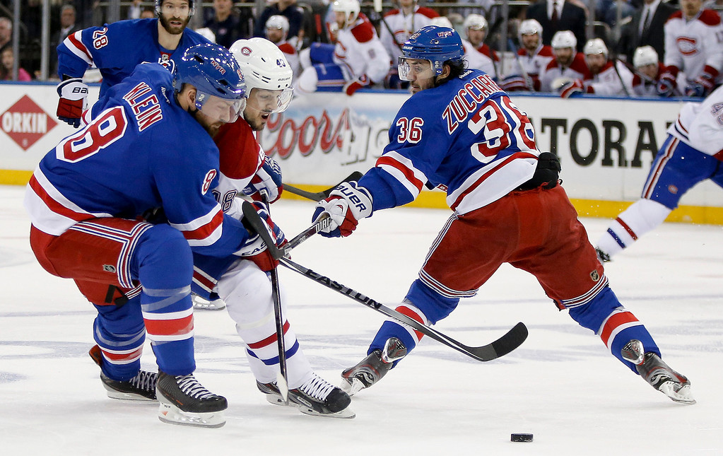 . New York Rangers defenseman Kevin Klein (8) and right wing Mats Zuccarello (36) double battle Montreal Canadiens center Daniel Briere (48) for the puck during the first period in Game 6 of the NHL hockey Stanley Cup playoffs Eastern Conference finals, Thursday, May 29, 2014, in New York. (AP Photo/Kathy Willens)