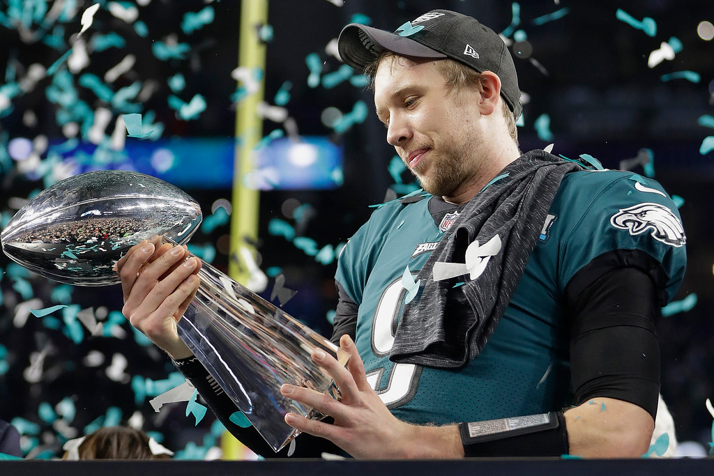 . Philadelphia Eagles\' Nick Foles holds up the Vince Lombardi Trophy after the NFL Super Bowl 52 football game against the New England Patriots, Sunday, Feb. 4, 2018, in Minneapolis. The Eagles won 41-33. (AP Photo/Mark Humphrey)