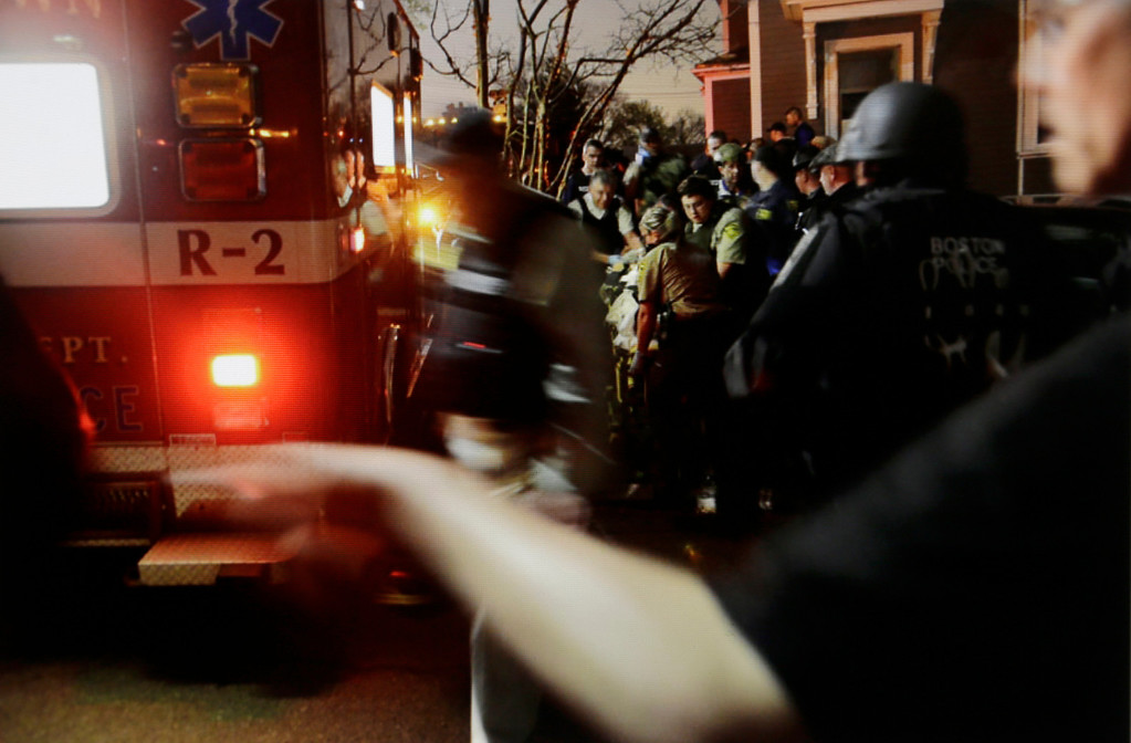 . In this Friday, April 19, 2013 Massachusetts State Police photo, 19-year-old Boston Marathon bombing suspect Dzhokhar Tsarnaev is placed into an ambulance by medical personnel following his capture by law enforcement authorities in Watertown, Mass. (AP Photo/Massachusetts State Police, Sean Murphy)