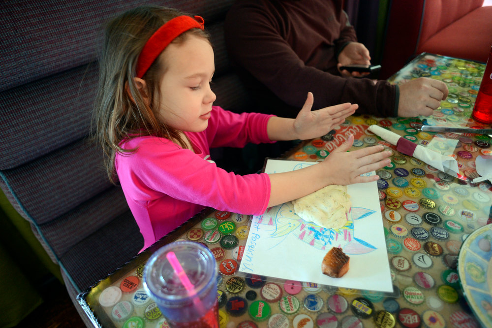 . DENVER, CO. - JANUARY 20: Hazel Anderson 5-years-old plays with pizza doe at Pasquini\'s January 21, 2013 in Denver. The story is about kid-friendly places to eat that also please adults. (Photo By John Leyba / The Denver Post)