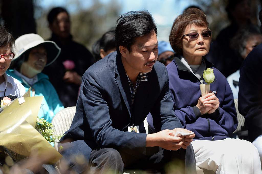 . A man identified as the father of Asiana crash victim Wang Linjia is photographed at a prayer ceremony for the Asiana Flight victims put on by the Tzu Chi Foundation in Burlingame, Calif., on Saturday, July 13, 2013. Tzu Chi is an international Buddhist relief organization that began in Taiwan and offers compassionate efforts for charity, medical treatment, education and disaster relief.  (Dan Honda/Bay Area News Group)