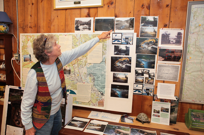Jones River Watershed Assocoaiton  Executive Director, Pine duBoise shows photos of the many dam removal projects completed over the years. Wicked Local Photo/Denise Maccaferri