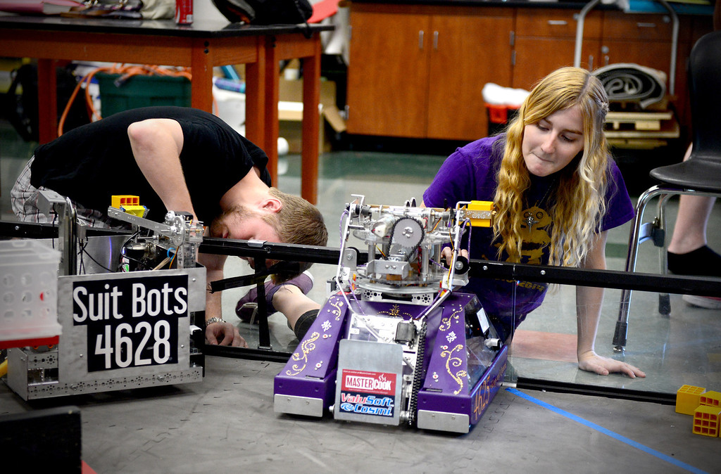 """. Melissa Johnson, 16, of The King and Queens, of Monrovia High\'s Robotics, sets up her team\'s robot \""""Your Heiness\"""" as they practice for the World Championships Tuesday, April 8, 2014. The King and Queens, an all girl team, qualified to advance to the 2014 First Tech Challenge Robotics World Championships after competing in the West Super-Regional Robotics Tournament at McClellan Air Force Base this past weekend. The Monrovia team, the only qualifier from the Los Angeles area, joins three San Diego teams and four Northern California teams to be among the 128 top teams from around the world to compete at the First Robotics World Championships. (Photo by Sarah Reingewirtz/Pasadena Star-News)"""