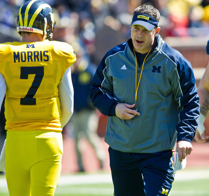 . Michigan quarterback Shane Morris (7) gets some feedback from offensive coordinator Doug Nussmeier during the football team\'s annual spring game, Saturday, April 5, 2014, in Ann Arbor, Mich. (AP Photo/Tony Ding)