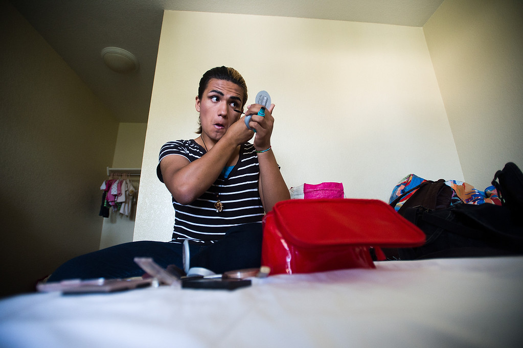 . Patrick Cordova, 15, gets ready for his day at a Motel 6 where his family is living in El Monte, Calif. on Thursday, Sept. 6, 2013. Cordova is a transgender senior at Azusa High who was voted in the top 5 for homecoming queen. (Photo by Watchara Phomicinda/ San Gabriel Valley Tribune)