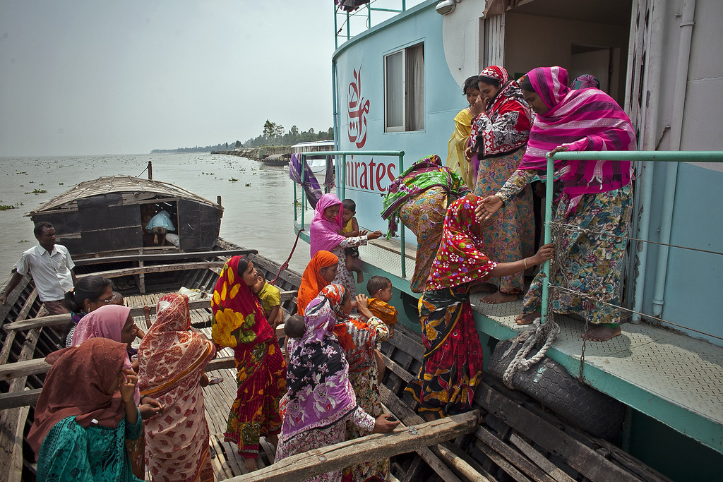 """. Women from the Modafot village arrive at the Emirates Friendship Floating Hospital May 19, 2014 in the Chilmari district, Bangladesh. Friendship floating hospitals dock for up to 5 months at remote islands, or \""""chors\"""", in the north of Bangladesh with a full medical team and stocked pharmacy, providing health care at affordable cost.  (Photo by Allison Joyce/Getty Images)"""