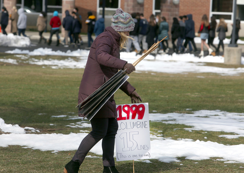 . A sign commemorating the 1999 Columbine High School shooting is collected with other commemorative signs as students at Wissahickon High School return to class after participating in a walkout Wednesday March 14, 2018 in Ambler, Pa. Students across the United States walked out of school Wednesday to protest gun violence. (AP Photo/Jacqueline Larma)