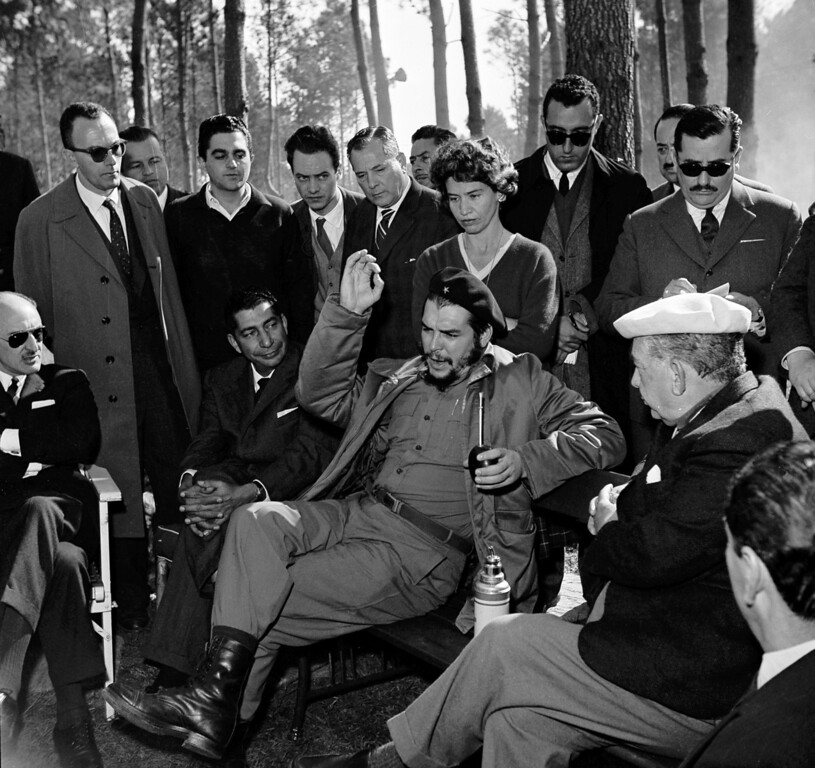 ". Cuban Industry Minister Ernesto ""Che\"" Guevara holds a mate (tea) gourd in one hand while gesturing with the other during a visit with Uruguay\'s President Victor Haedo, right, at Haedo\'s summer home in Punta del Este, Uruguay, Aug. 7, 1961. Guevara is here for the Inter-American Economic and Social Conference.  (AP Photo)"