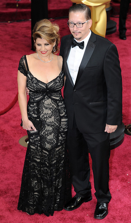 . Makeup artist Stephen Prouty and guest attends the 86th Academy Awards at the Dolby Theatre in Hollywood, California on Sunday March 2, 2014 (Photo by John McCoy / Los Angeles Daily News)
