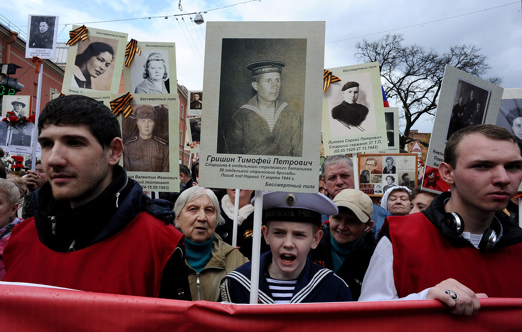 . People carry portraits of World War II veterans during Victory Day celebrations in St. Petersburg, on May 9, 2014. AFP PHOTO / OLGA  MALTSEVA/AFP/Getty Images
