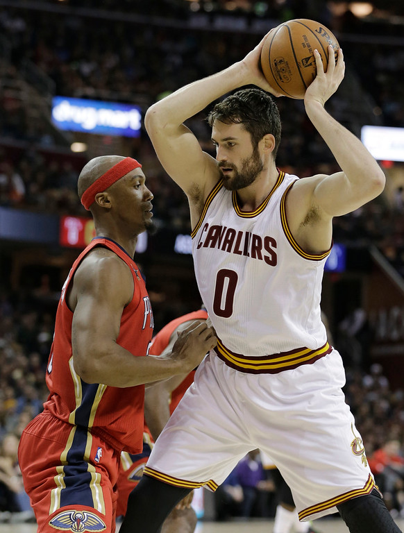 . Cleveland Cavaliers\' Kevin Love (0) drives against New Orleans Pelicans\' Dante Cunningham (33) in the first half of an NBA basketball game, Monday, Jan. 2, 2017, in Cleveland. (AP Photo/Tony Dejak)