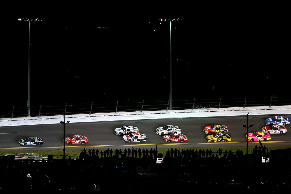 . DAYTONA BEACH, FL - JULY 06:  Denny Hamlin, driver of the #11 FedEx Ground Toyota, leads a pack of cars during the NASCAR Sprint Cup Series Coke Zero 400 at Daytona International Speedway on July 6, 2013 in Daytona Beach, Florida.  (Photo by Mike Ehrmann/Getty Images)