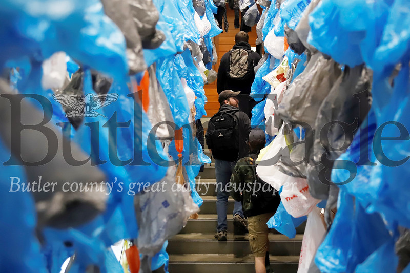 Students walk through a plastic bag display at the Beyond Plastic symposium at Slippery Rock University Thursday. Seb Foltz/Butler Eagle