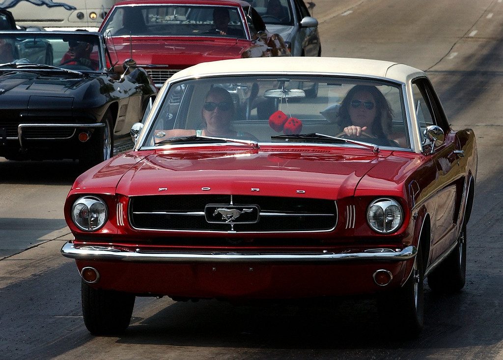 . (left) Rose and Sara Bejma, of Oxford, cruise along Woodward Avenue in Pontiac, in a 1965 Ford Mustang.(Oakland Press Photo/Vaughn Gurganian)