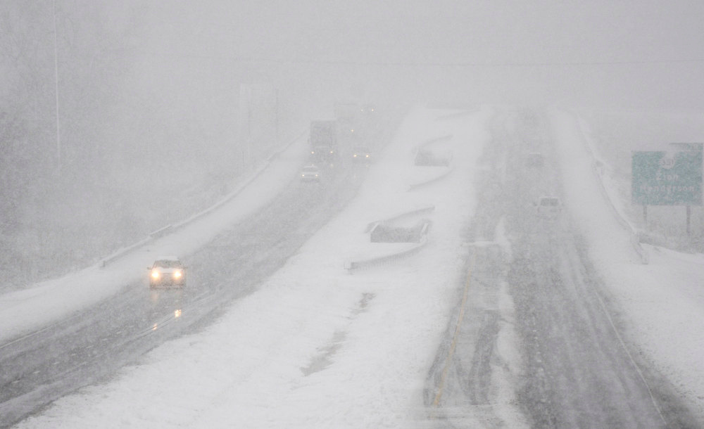 . Traffic moves in the U.S. 41 By-Pass in Henderson, Ky., Wednesday, Dec. 26, 2012 as a snow storm moves through the area making travel treacherous. (AP Photo/The Gleaner, Mike Lawrence)