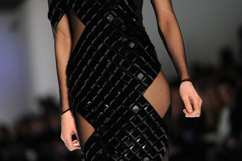 . A dress detail is seen as a model walks the runway during Akris Fall/Winter 2013 Ready-to-Wear show as part of Paris Fashion Week on March 3, 2013 in Paris, France.  (Photo by Pascal Le Segretain/Getty Images)